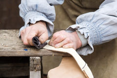 Leather craftsmen. Leather craftsmen making shoes by hand Royalty Free Stock Image