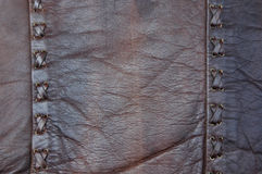 Leather Cross Stitch. Brown leather material with cross stitch pattern stock photo