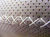 Leather cross stitch Stock Photo