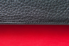 Leather detail. Black and red leather from a fashionable bag in close up Stock Images