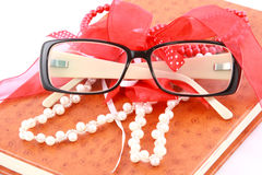 Leather diary with classic glasses and pearl beads Royalty Free Stock Photography