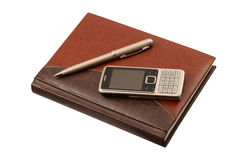 Leather diary, pen and mobile phone. On white background Royalty Free Stock Image