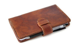 Leather diary system. Hand-planted brown cowhide diary Stock Images
