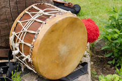 Leather drum with African motifs outdoor. Old leather drum with African motifs outdoor Stock Images