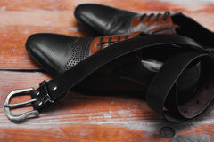 Leather executive shoes with belt. Male leather executive shoes with belt Stock Images