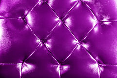 Leather fabric. Close-up of a leather chair fabric Royalty Free Stock Photography
