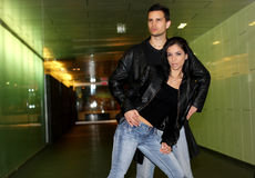 Leather fashion. Urban couple posing wearing leather jacket stock image