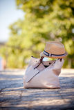 Leather Female Bag and Textile Hat on Street Pavement Royalty Free Stock Photography