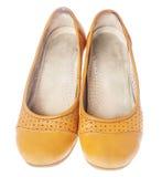 Leather flat shoes. Comfortable orange leather flat shoes isolated on white Royalty Free Stock Image
