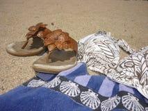 Leather flip flops with bikini and beach towel Stock Photos