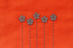 Leather flowers on embroidery pattern Stock Photo