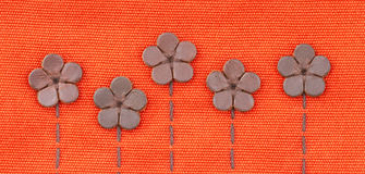 Leather flowers on embroidery pattern Royalty Free Stock Photos