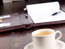 Leather folder and a cup of coffee Royalty Free Stock Image