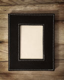Leather frame on wood Royalty Free Stock Photos
