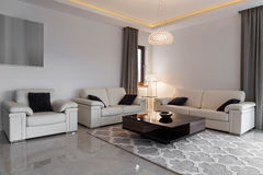 Leather furniture in elegant lounge. White leather furniture in elegant modern lounge royalty free stock photography