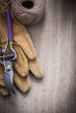 Leather gardening gloves sharp metal secateurs and hank of twine Stock Images