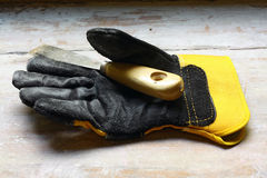 Leather gauntlet. Leather gauntlet on windowsill in natural light running by windows during repair stock photo