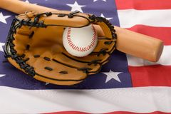 Leather glove with baseball and baseball bat Royalty Free Stock Photography