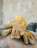 Leather glove and saddle Royalty Free Stock Photography