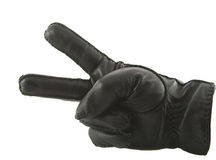 Leather glove showing victory. Isolated over white Royalty Free Stock Photos