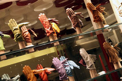 Leather gloves. Coloured leather gloves in the store Stock Images