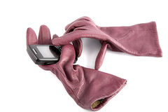 Leather gloves compress cellular telephone Royalty Free Stock Photos