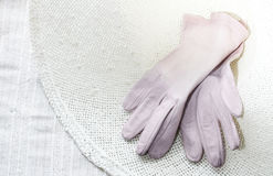 Leather Gloves in a hat 1 royalty free stock images