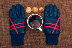 Leather gloves next to a hot cup of coffee Stock Photography
