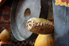 Leather gonger/mallet near the gong Royalty Free Stock Photos