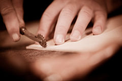 Leather goods craftsman at work in his workshop Royalty Free Stock Images