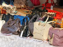 Leather goods and handbags for sale. At a flea market stall Royalty Free Stock Images