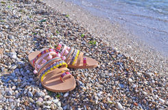 Leather greek sandals on the beach Stock Photo