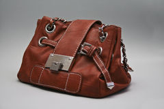 Leather Hand Bag. Brown leather hand bang isolated on grey background Royalty Free Stock Images
