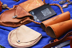 Leather hand-made. Group of hand-made leather produkts, blue background Royalty Free Stock Images