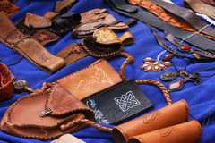 Leather hand-made. Group of hand-made leather produkts, blue background Royalty Free Stock Photo