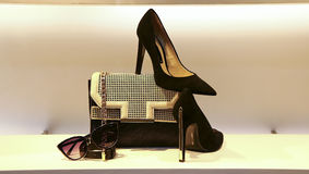 Leather handbag, shoes and sunglass for women. Elegant genuine leather handbag, suede shoes, and sunglass for ladies on display Royalty Free Stock Image