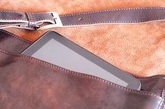 Leather handbag with tablet inside. Leather handbag detail with tablet inside Royalty Free Stock Photo
