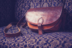 Leather handbag on vintage sofa Royalty Free Stock Photo