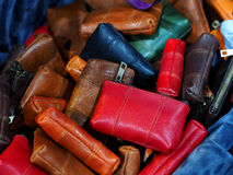 Leather handbag or wallet pile for woman Stock Photos