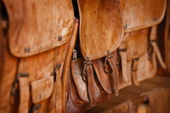 Leather handbags in the open market Stock Images