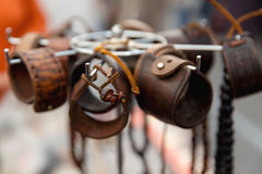 Leather handmade souvenir bracelets. At the street market - shopping background stock photos