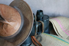 Leather Hat, Vintage Binoculars and Burlap Stock Photography