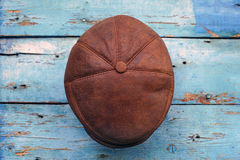 Leather headgear  on a wooden wall Royalty Free Stock Photos