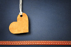 Leather heart on blue background Royalty Free Stock Images