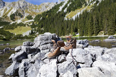 Leather hiking shoes in Alps Stock Photography