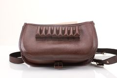 Leather hunting bag with brown ornament with patronage on white  background Stock Image