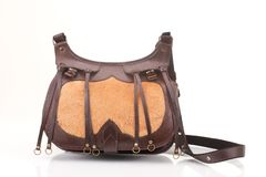 Leather hunting bag with brown ornament with patronage on white  background Stock Photos