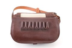 Leather hunting bag with brown ornament with patronage on white  background Stock Photography