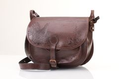Leather hunting bag with brown ornament with patronage on white isolated background Stock Image