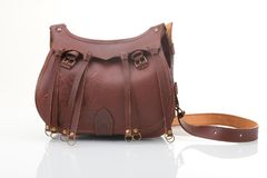 Leather hunting bag with brown ornament with patronage on white isolated background Stock Images